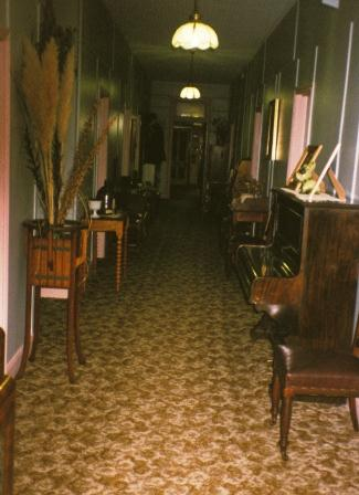 "National Park Hotel, interior hallway. The word ""quaint"" comes to mind, meaning ""pleasingly old fashioned."""