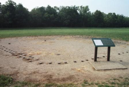 Excavation of a mound revealed that it had been constructed over a charnel house (the walls indicated by the posts), which had been burned along with the accumulated human remains it had housed.