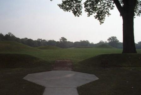 A defining boundary ring a few feet high contains various sizes and shapes of mounds.