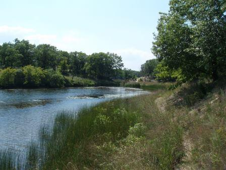 The Miller Woods Trail eventually skirts a large pond at the edge of the dunes, and reaches the beach.