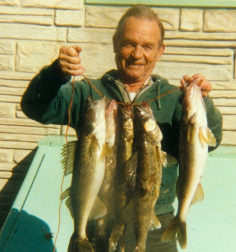 Fishing was Dad's favorite activity. With walleyes, 1987.