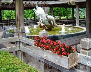 This dolphin fountain is part of an area that once was a center for equestrian events.